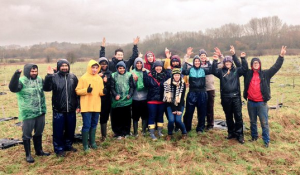 Group photo in the rain after planting all the trees.