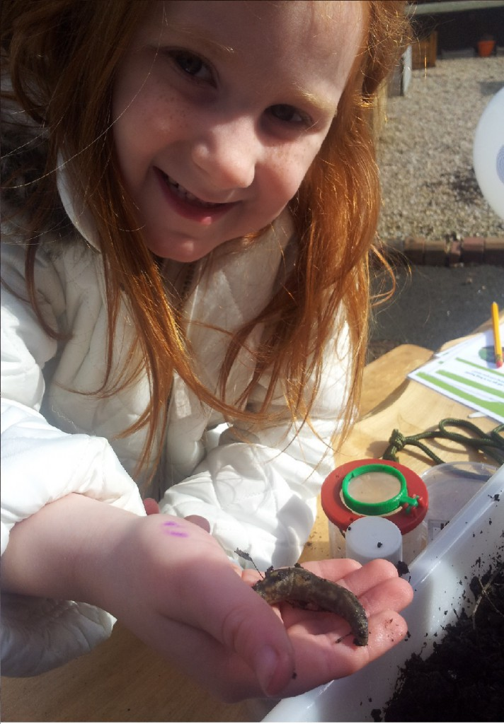 A little participant studying slugs