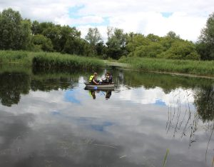 Fun with boats on the pond at Magor Marsh
