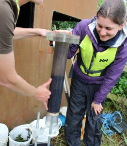 Look at all that sediment! Processing a core at the pond side