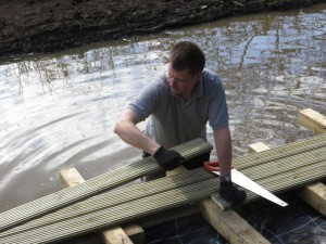 Installing decking from the pond