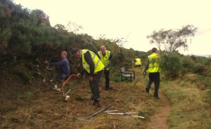 Hard at work opening up the bridal way and footpath along the edge of Braid Hills.