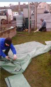 Re-purposing old material to create weed suppressors at the Friary Community Garden