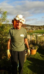 Modelling the latest in vegetable hat wear at the Friary Community Garden