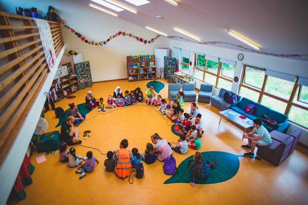 TCV Skelton Grange team with school children